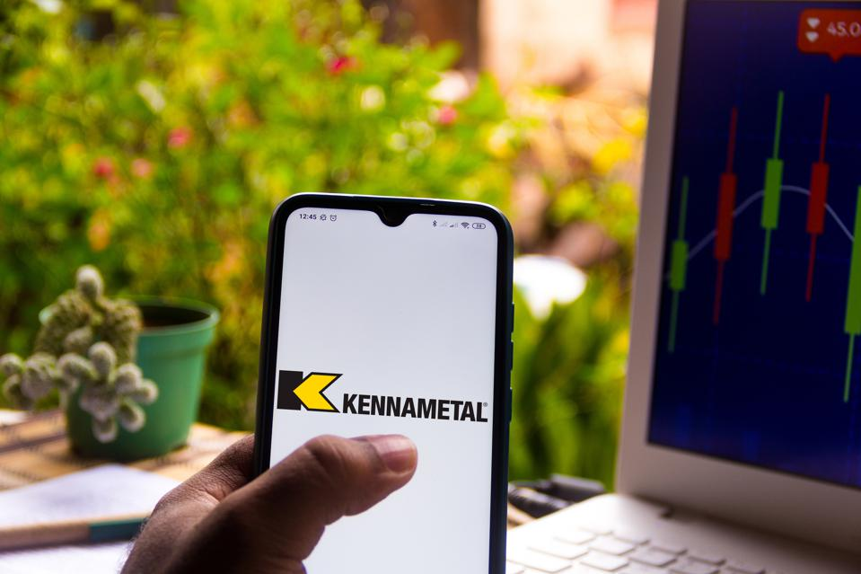 In this photo illustration the Kennametal logo seen...