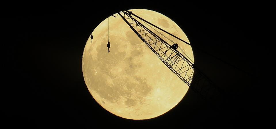 A full ″Beaver Moon″ rises behind a crane in Manhattan, New York City on November 29, 2020.