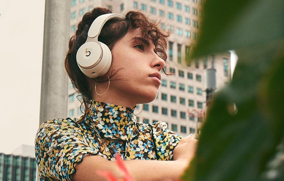 Women wearing beats headphones