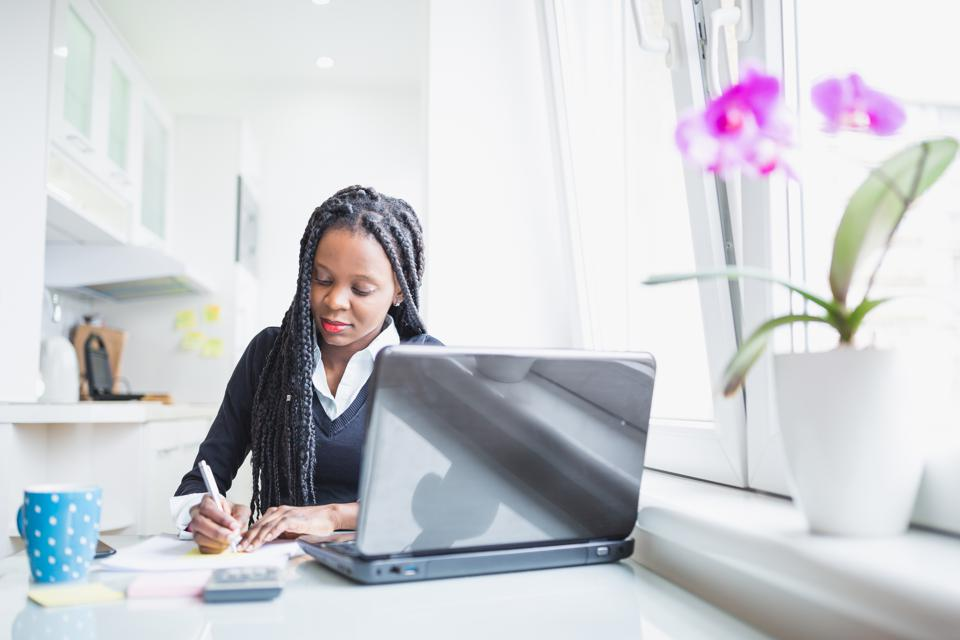 Young African American Woman working at home