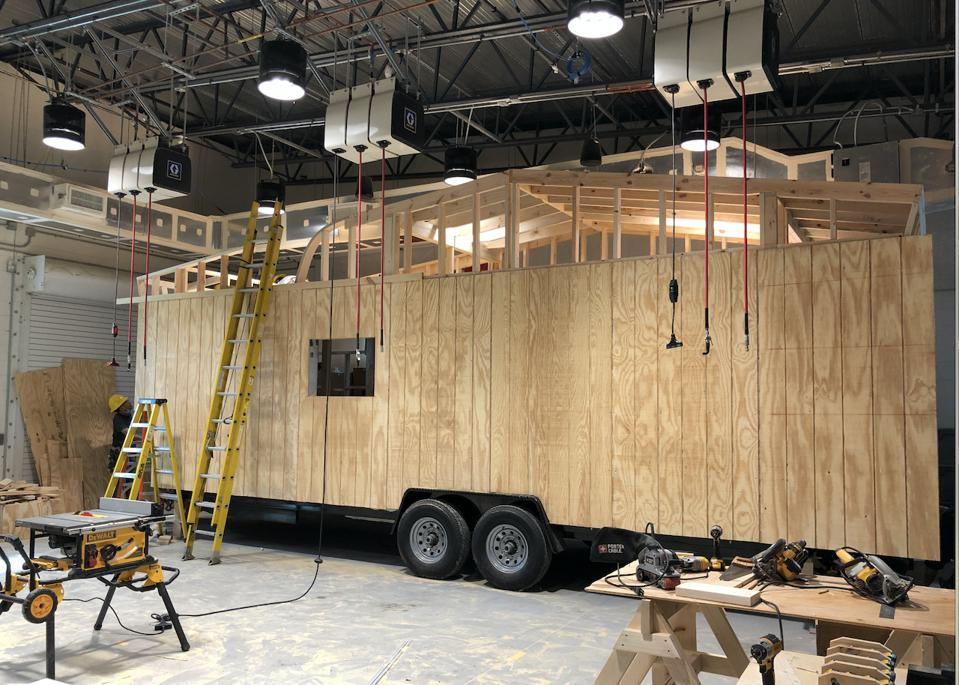 A work-in-progress tiny home, being built inside a warehouse at Valencia Collge's Osceola, Fla., campus at the Construction Accelerated Skills Training Building.