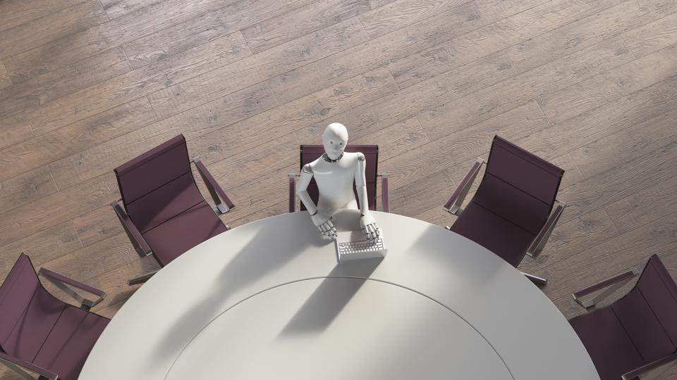 Robot sitting sitting at conference table, using laptop
