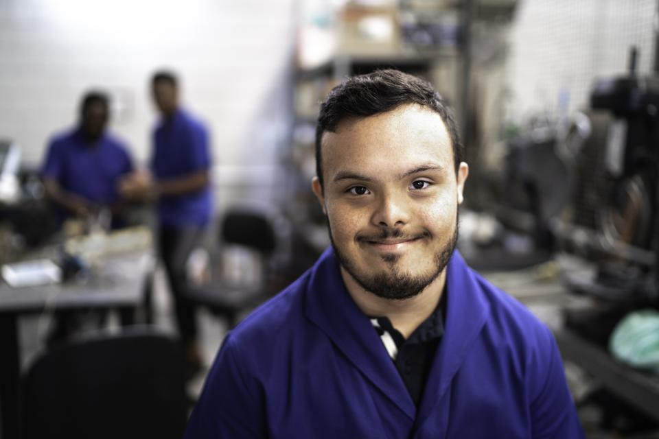 Portrait of special needs employee in industry