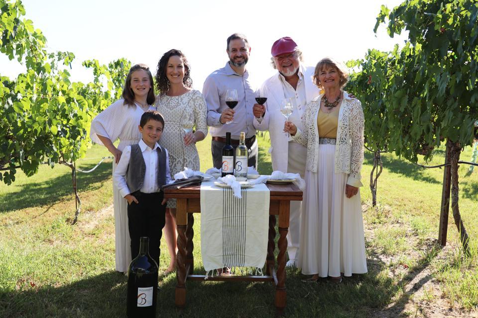 The Bonarrigo family in the vineyards.