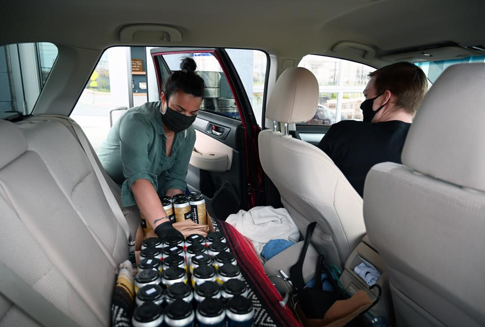 Thomas Brems of Carhop makes a beer delivery