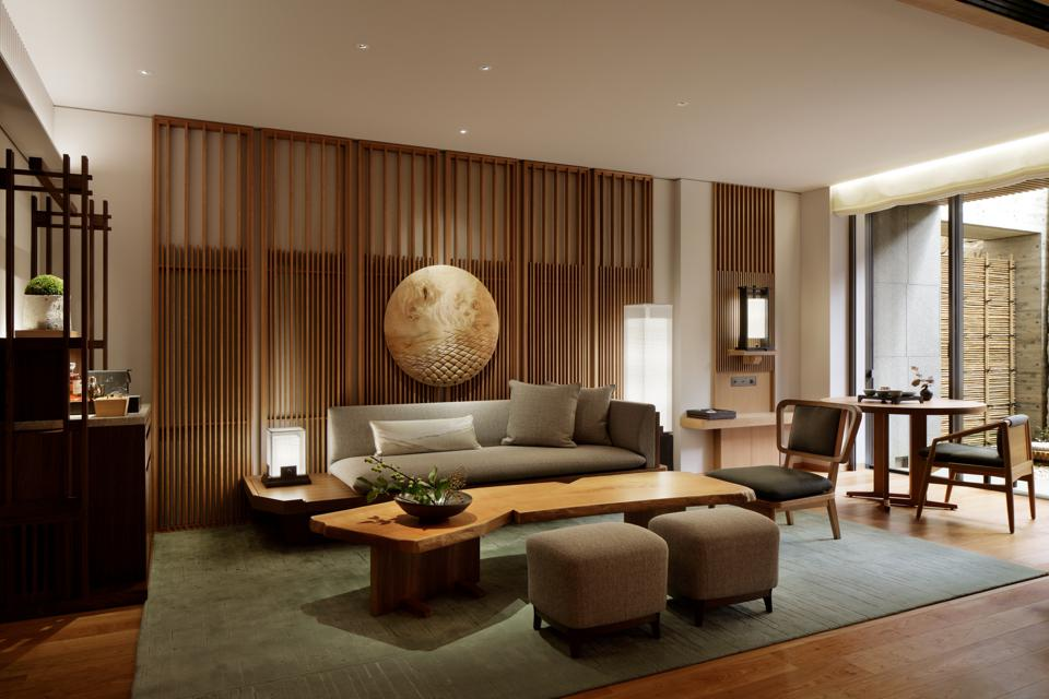 Sleek, contemporary furniture in beige and brown tones in a suite living room.