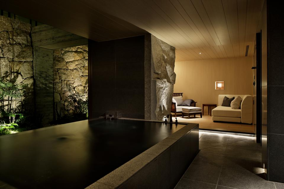 A small rectangular pool surrounded by stone walls