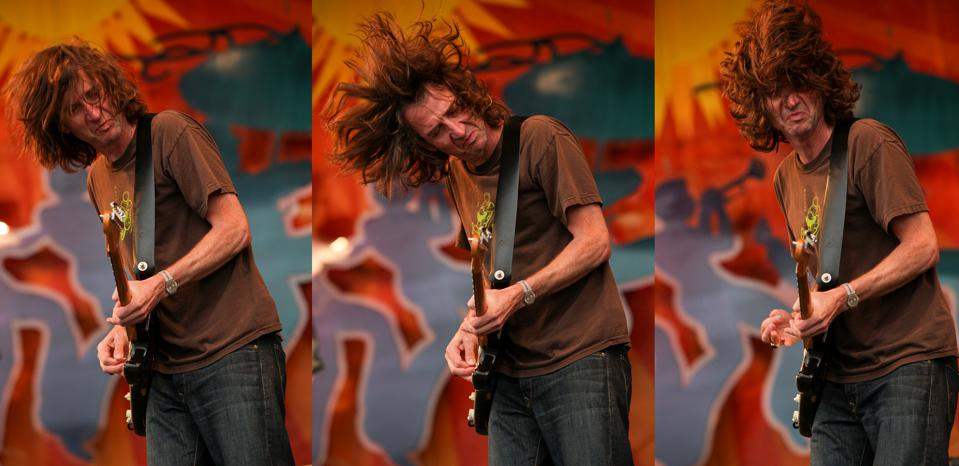 Guitarist Stone Gossard performs on stage at the New Orleans Jazz and Heritage Festival with Pearl Jam. May 1, 2010 in New Orleans, LA (Photo by Barry Brecheisen)
