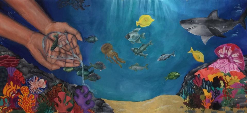 A mural, created by students at Smithtown High School East in St. James, N.Y., hangs in the local town hall.