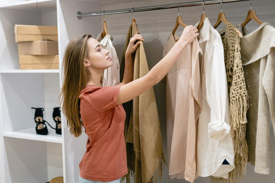 Young adult girl standing near wardrobe at home