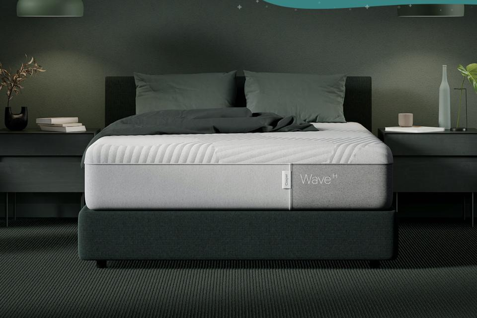 Casper Wave Hybrid mattress set up in a room with lots of green detail.