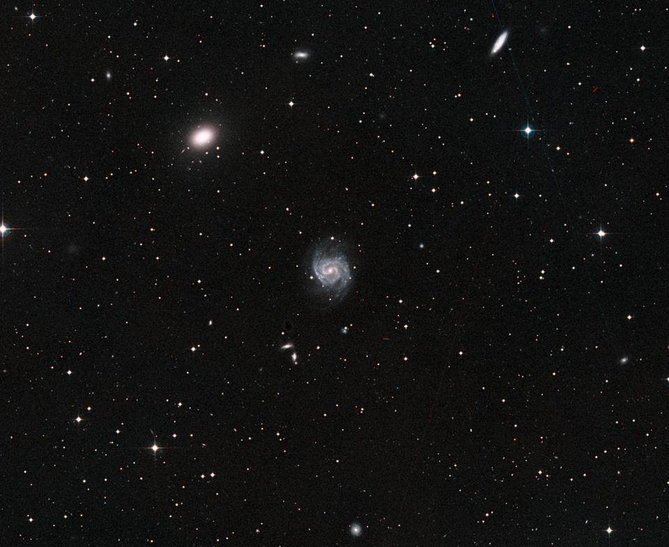 This wide-field view shows galaxy NGC 1052 (top left) and nearby galaxy NGC 1042 (center).