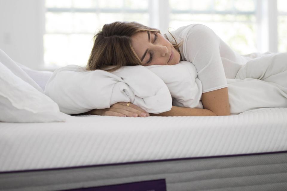 Woman sleeping on a Purple Hybrid Premier 4 mattress