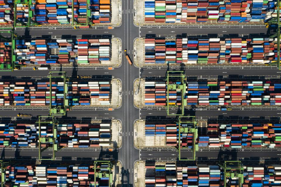 Stunning aerial view of the port of Singapore with trucks and thousands of colored containers ready to be loading on some cargo ships.