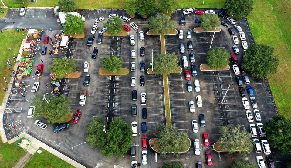 (EDITORS NOTE: Image taken with drone) Residents line up in...