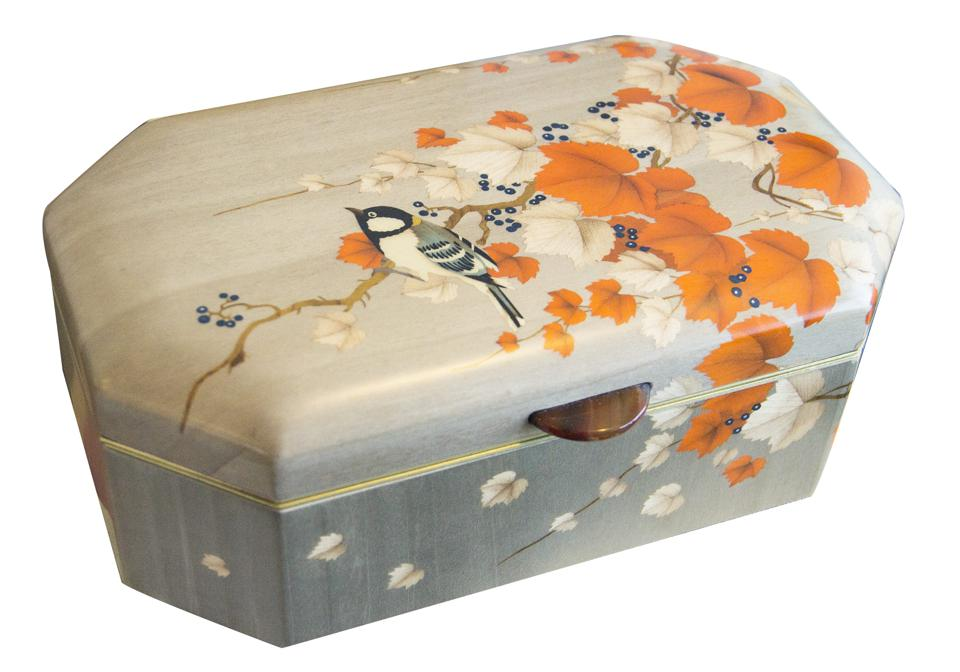 A beautiful jewelry box with a painting of a bird and flowers.