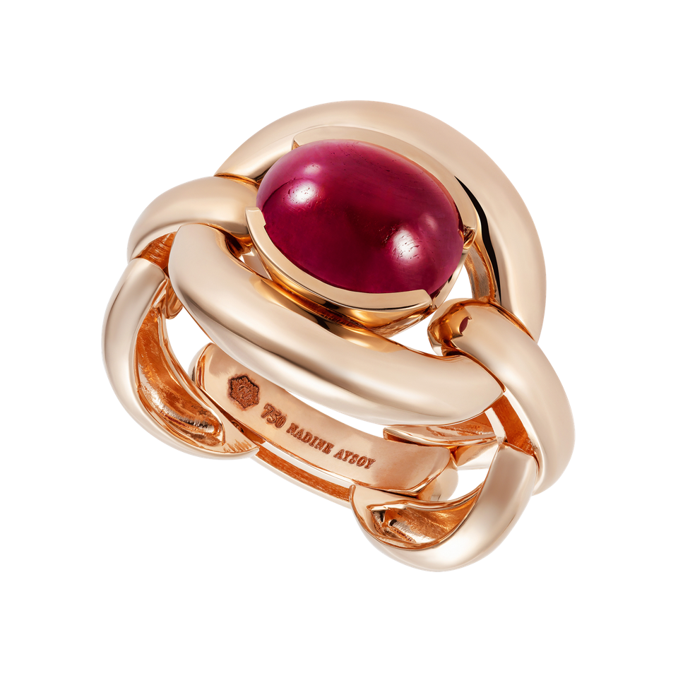 The 18-karat gold Caetana ring by Nadine Aysoy is centered with an oval cabochon ruby