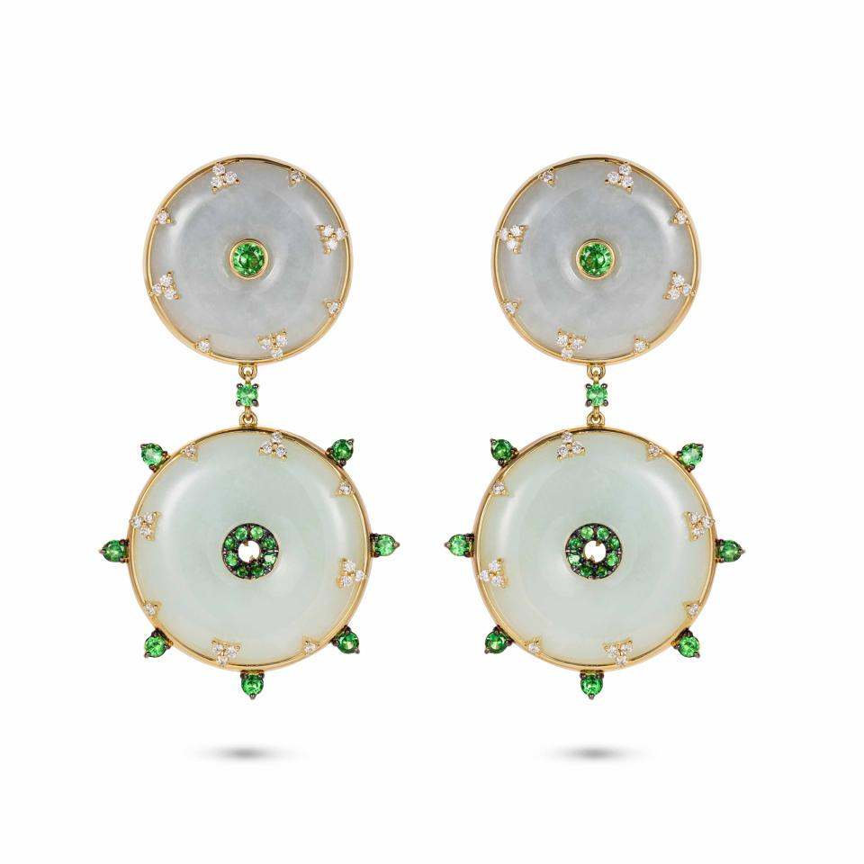 Circular white jade earrings with tsavorite garnets are sprinkled with diamonds