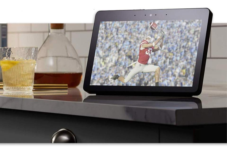 Fire TV Recast set up on a bar table playing a football game.