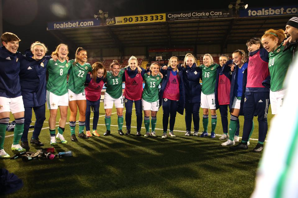 Northern Ireland's players form a huddle after the final whistle