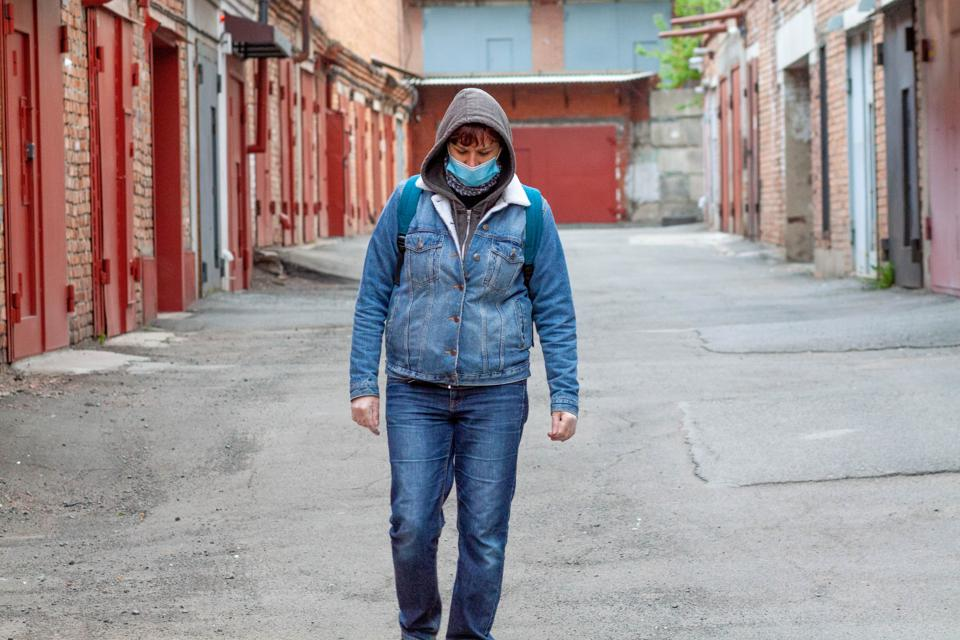 A woman wearing protective mask and gloves during quarantine during Covid-19 outbreak