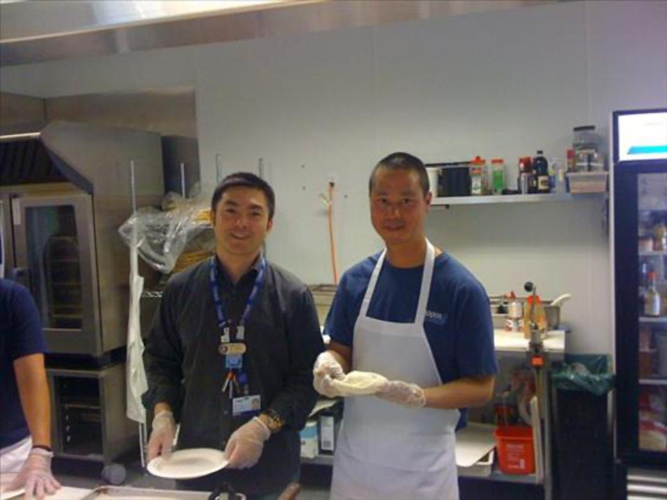 Alfred Lin and Tony Hsieh make pizzas for Zappos.