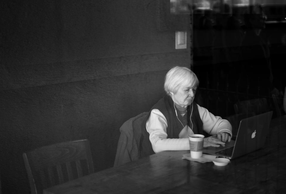 Starbucks Coffee shop customer using free wifi