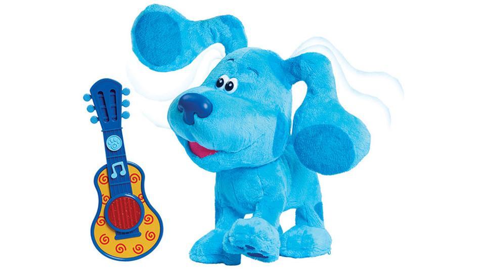 stuffed blue dog and guitar