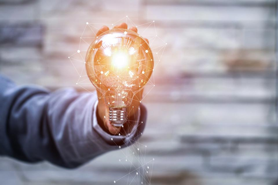 Business man holding light bulbs, ideas of new ideas with innovative technology and creativity