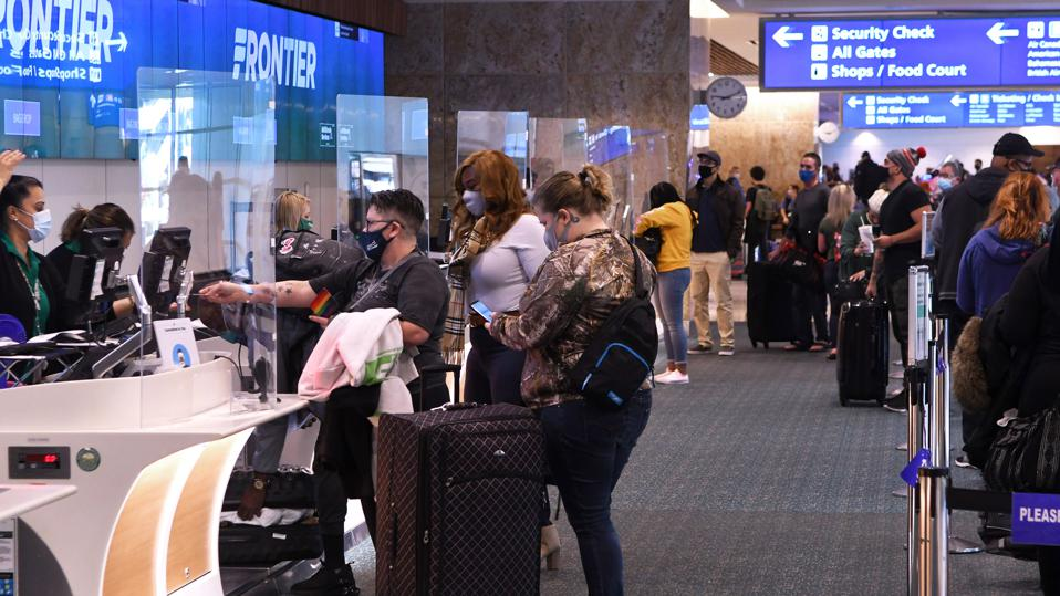 People Travel For Thanksgiving Despite CDC Warnings