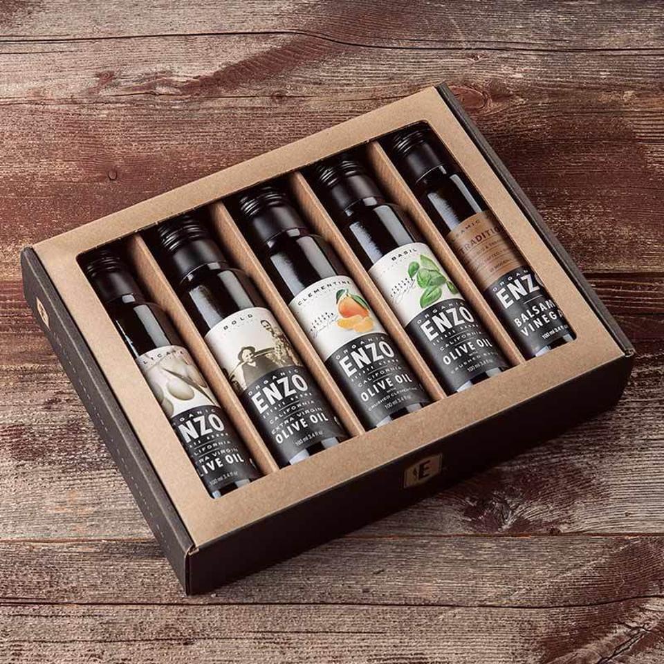 olive oil bottles, balsamic vinegar, clementine, basil, Extra Virgin Olive Oils