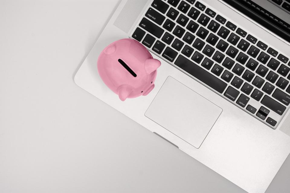 Top View of Piggy Bank on Laptop