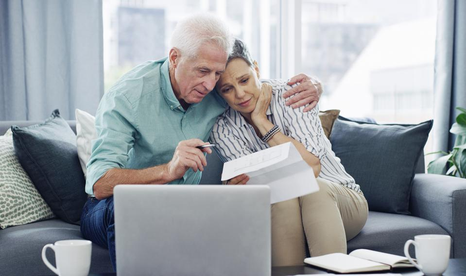 Shot of a senior couple going through paperwork at home