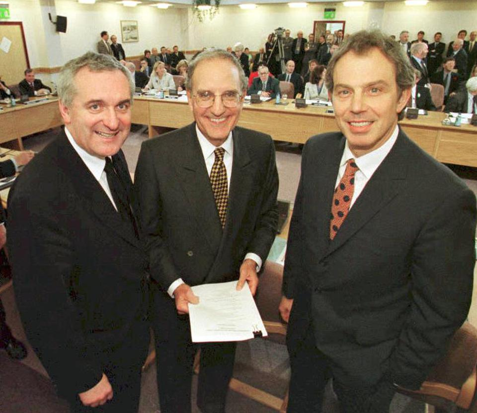 10 Apr 1998: British Prime Minister Tony Blair (R), Special Envoy U.S. Senator George Mitchell (C) and Irish Prime Minister Bertie Ahern (L) after signing the historic Good Friday Agreement for peace in Northern Ireland, ending a 30-year conflict.