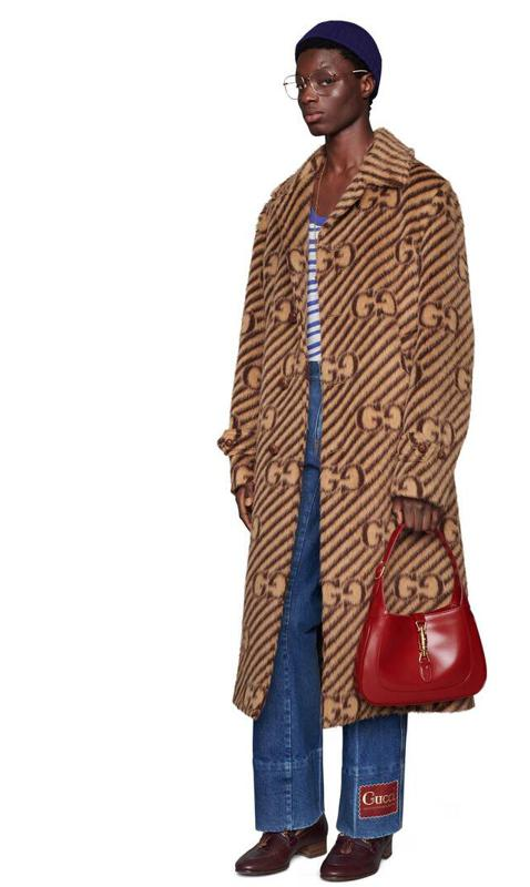 GG stripe wool coat with Gucci label  This wool coat is classic and in the spirit of the heritage of the brand.