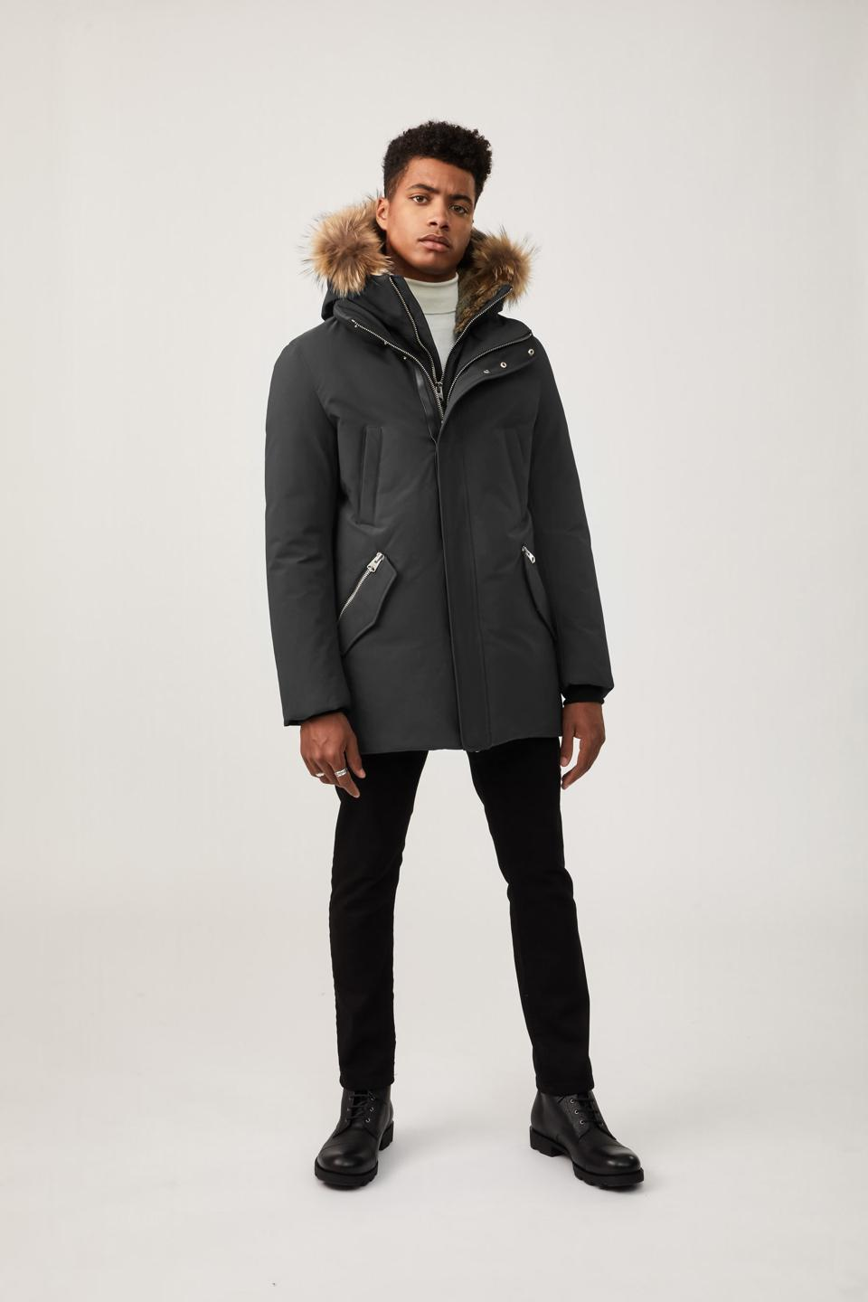 Nordic Tech down coat designed to be windproof, water-repellent and breathable, it features storm cuffs, a removable hooded bib, and a removable natural fur trim around the hood.