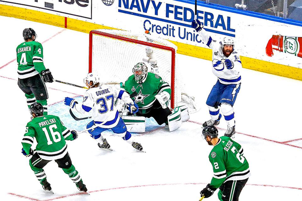 Pat Maroon of the Tampa Bay Lightning, right, celebrates the game-winning goal in overtime by teammate Kevin Shattenkirk (not pictured) to give the Lightning a 5-4 victory against the Dallas Stars during the fourth game of the Stanley Cup finals.