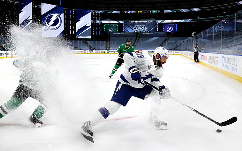 Barclay Goodrow of the Tampa Bay Lightning stays ahead of a Dallas Stars defender in the fourth game of the NHL Stanley Cup finals.