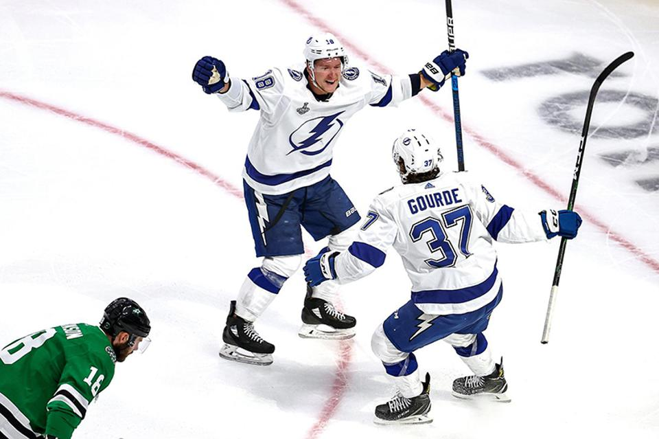 Yanni Gourde of the Tampa Bay Lightning, right, is congratulated by Ondrej Palat after scoring a goal against the Dallas Stars during the fourth game of the 2020 NHL Stanley Cup finals.
