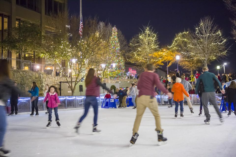 People skating in an open air ice rink in Greenville.
