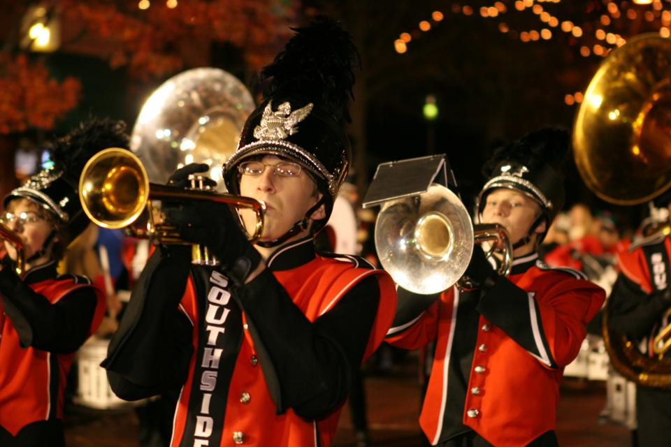 A holiday marching band in a parade in Greenville.