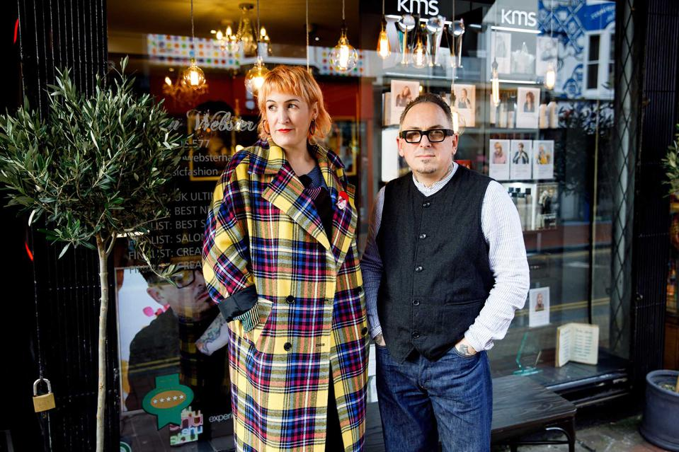 Sophie and Simon Webster stand in front of their hairdressers in Brighton
