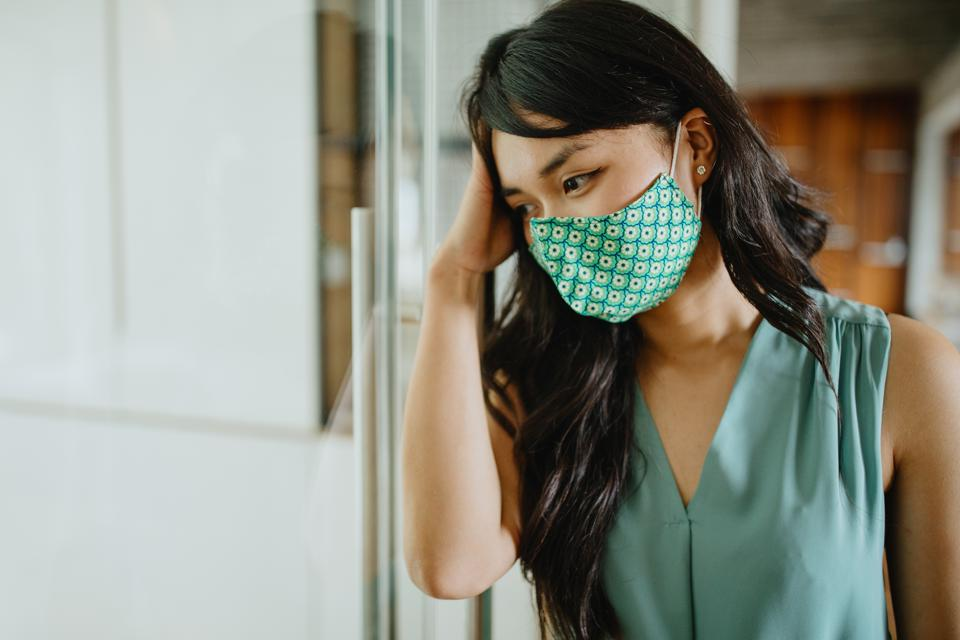 Businesswoman stressed out due to Coronavirus