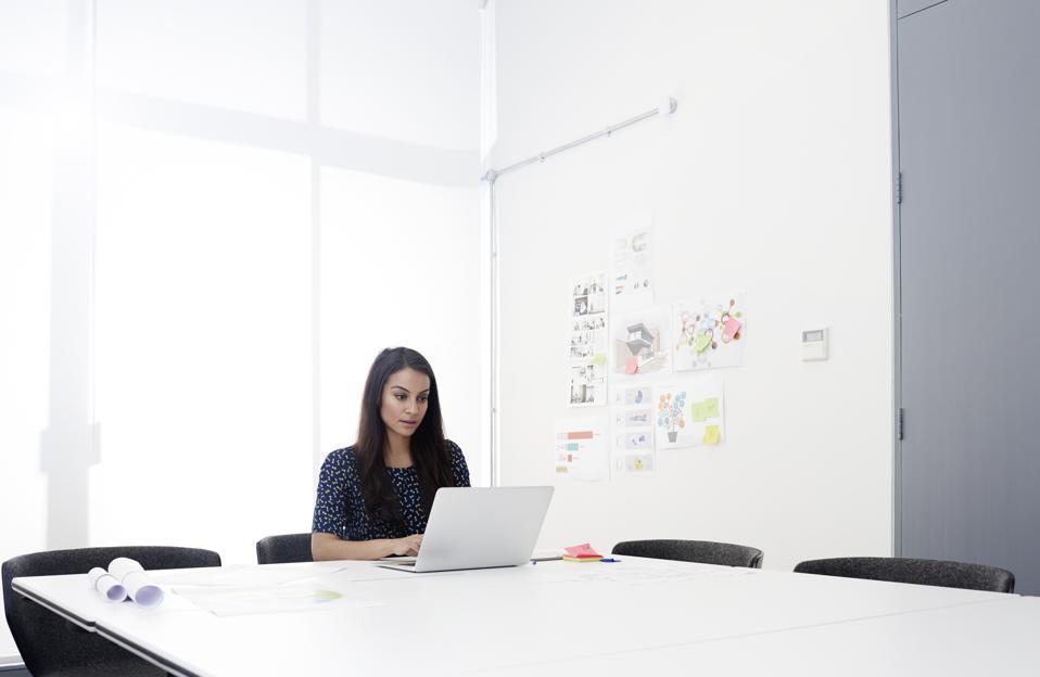 Female employee working in a clean office.