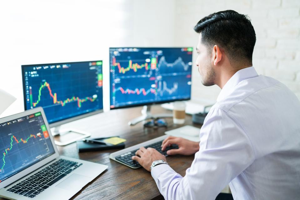 Stock trader looking at financial data
