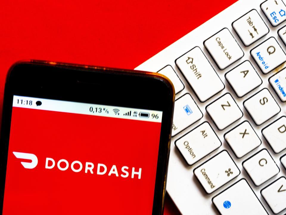 In this photo illustration a DoorDash Inc. logo seen...