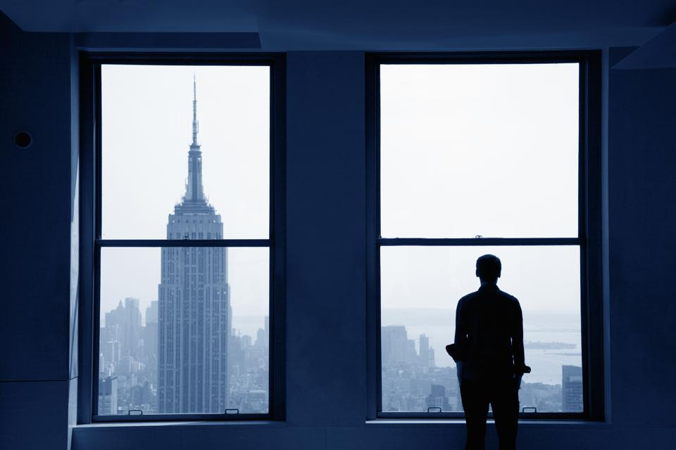 Young man looking out at Manhattan skyline
