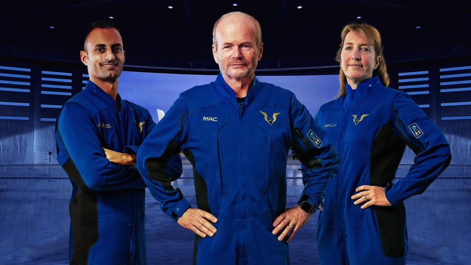Three Virgin Galactic pilots wearing the new Under Armour spacesuits