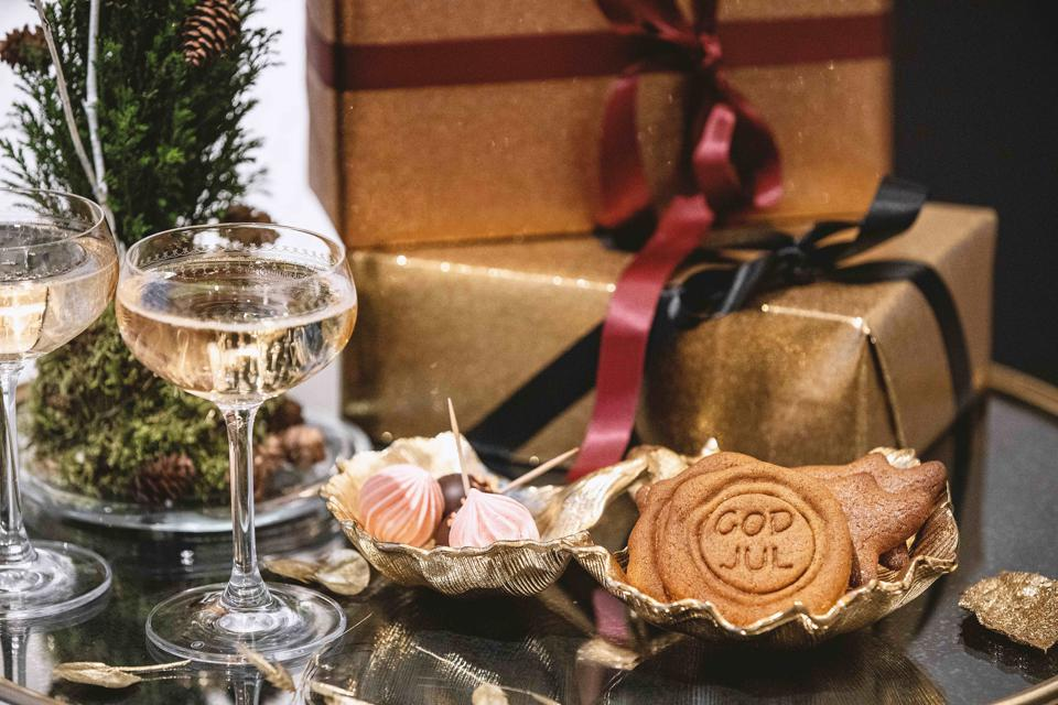 Wrapped Christmas presents, cookies and Champagne are presented at a hotel in Norway.