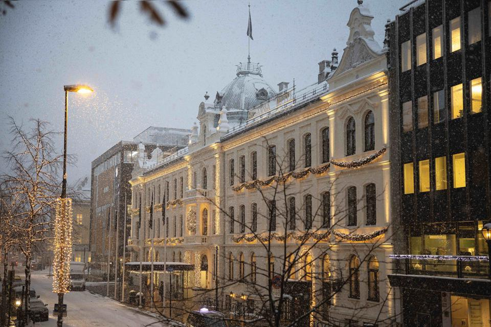 The Britannia Hotel in Trondheim, Norway, is decorated with Christmas lights in the snow.